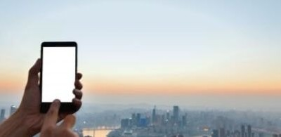hand-touching-a-mobile-screen-with-city-background_1112-855 (1)