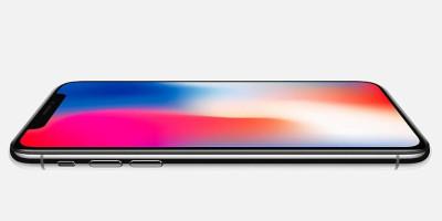 iPhone X preto na horizontal, com a tela virada para cima, simbolizando as dicas de presente de Natal.
